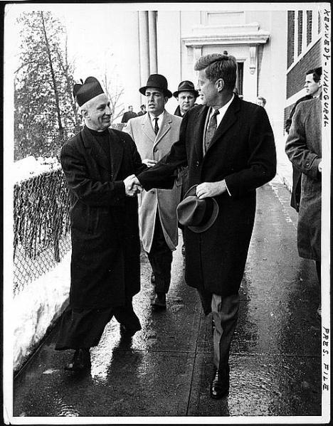 Newly Elected President John F. Kennedy  shown with Father Richard J. Casey, pastor of Holy Trinity Church, where J.F.K. attended Mass just prior to his inauguration on January 20, 1961