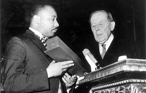 Dr. Martin Luther King, Jr. picking up the Nobel Prize for Peace from Gunnar Jahn, president of the Nobel Prize Committee, in Oslo on December 10, 1964