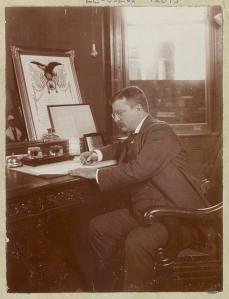 President Theodore Roosevelt signing his 1902 Thanksgiving Proclamation act
