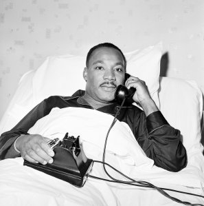 Dr. Martin Luther King Jr. recreates the moment he received word by phone that he has been awarded the Nobel Peace Prize as he lies in hospital bed in Atlanta, Ga., October 14, 1964, where he went for a checkup