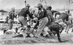 Alabama state troopers attacking the demonstrators on March 7, 1965