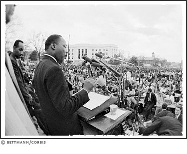Dr. Martin Luther King, Jr. speaks in front of the Alabama State Capitol, to an estimated 30,000 demonstrators who followed him on the last leg of the Selma-Mongomery Civil Rights Marches on March 25, 1965.