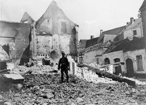 A Belgian sentry in front of destroyed property in Antwerp, Belgium in September 1914.
