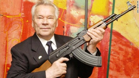 "Mikhail Kalashnikov presents his legendary assault rifle to the media while opening the exhibition ""Kalashnikov - Legend and Curse of a Weapon"" at a weapons museum in Suhl, eastern Germany, in 2002"