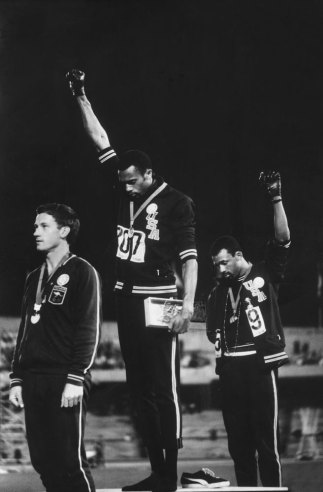 Gold medalist Tommie Smith (center) and bronze medalist John Carlos (right) raise black-gloved fists during the American national anthem at the 1968 Olympics in Mexico City. Australian sprinter Peter Norman, who won silver in the 200 meters and supported Carlos and Smith's protest, stands at left.  John Dominis—Time & Life Pictures/Getty Images