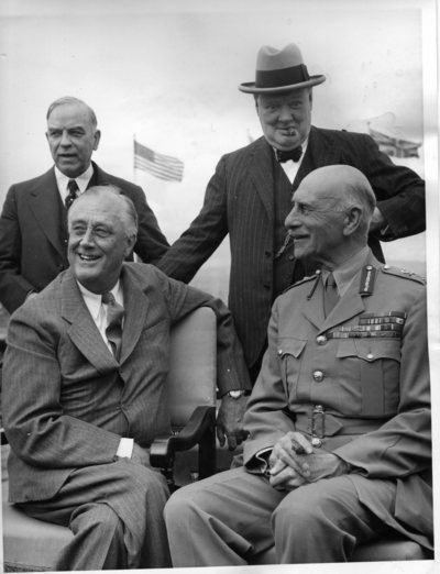 Winston Churchill,  and Canadian PM William Lyon Mackenzie King stand behind U.S. President Franklin Roosevelt and Canada's Governor-General, the Earl of Athlone, during the first Quebec Conference on Aug. 18, 1943