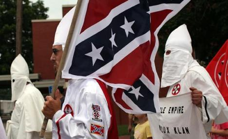 Members of the Fraternal White Knights of the Ku Klux Klan participate in the 11th Annual Nathan Bedford Forrest Birthday march July 11, 2009 in Pulaski, Tenn.