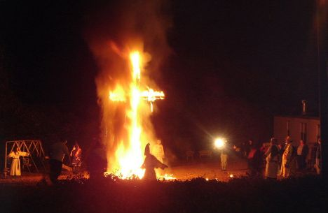 "Ku Klux Klansmen and women at a cross ""lighting"" (as opposed to ""burning"") on November 12th, 2005."