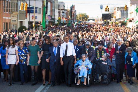 President Obama and Representative John Lewis led thousands in a commemorative march across the Edmund Pettus Bridge, 2015.  NYT