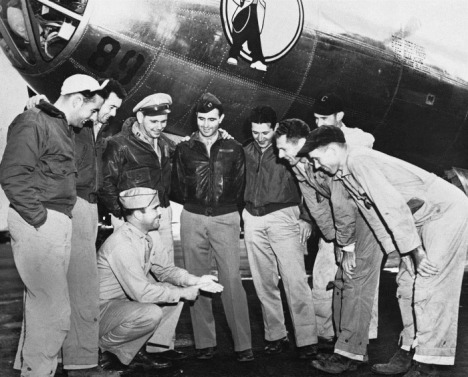 Happy crew members of the Nagasaki bombers after retiring to base.