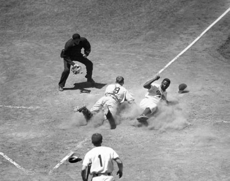 Jackie Robinson steals home during a game against the New York Giants in 1950
