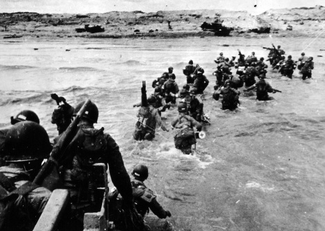 U.S. infantrymen wade toward Omaha Beach on D-Day; credit: U.S. Coast Guard/National Archives, Washington, D.C.