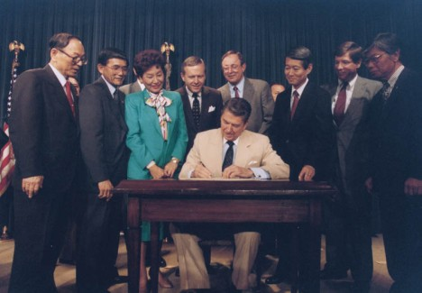 Ronald Reagan Signing the Reparations Bill