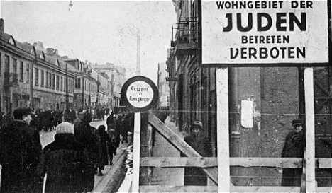 "A German postcard showing the entrance to the Lodz ghetto. The sign reads ""Jewish residential area—entry forbidden."" Lodz, Poland, 1940-1941. — US Holocaust Memorial Museum"
