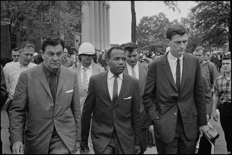 Chief U.S. Marshal James McShane (left) and Asst Atty General for Civil Rights, John Doar (right) of the Justice Dept, escorting James Meredith to class at Ole Miss