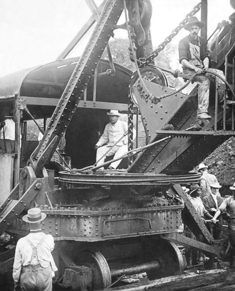 President Theodore Roosevelt sitting on a steam shovel at the Panama Canal, 1906