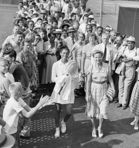 1950 - Althea Gibson and Alice Marble walking to the outer court at Forest Hills where Gibson's first match was scheduled.