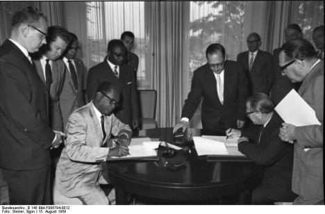 1959: Gbedemah (seated left) signs a finance agreement on behalf of Ghana with West Germany