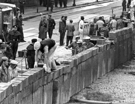 Construction of the Wall at Berlin's central Potsdamer Platz square on August 18, 1961, with GDR guards looking on