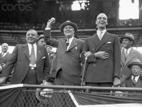 Chicago Mayor Anton Cermak (left) attends a 1932 World Series game with N.Y Governor and presidential candidate Franklin Roosevelt. On the right is FDR's son, James.