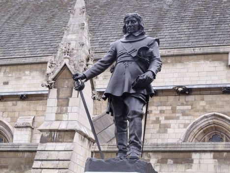Statue of Oliver Cromwell outside the Palace of Westminster. It is in front of Westminster Hall.