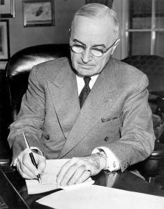 President Truman signing a proclamation declaring a national emergency that initiated U.S. involvement in the Korean War