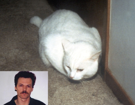 Convicted murderer Douglas Beamish and his cat Snowball. Photo by Dr. Stephen O'Brien