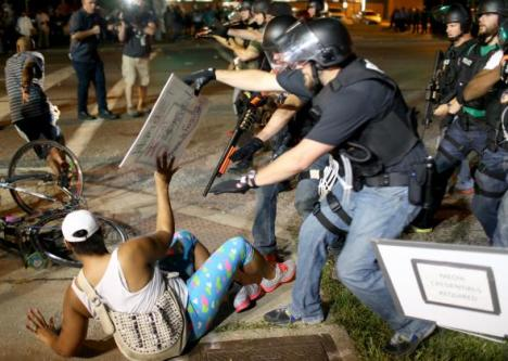 "As Slate captioned this picture:  ""The Ferguson Police Department seems unaware of the First Amendment. Also the Fourth, Fifth, Sixth, Eighth, Thirteenth, and Fourteenth.""  Photo by Joe Raedle/Getty Images"
