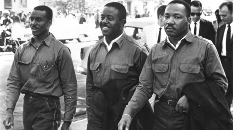 "Rev. Ralph Abernathy (center) with the Rev. Fred Shuttlesworth (left) and MLK Jr. (right), defying an injunction against protesting on Good Friday in 1963. They were arrested and held in solitary confinement in the Birmingham jail where King wrote his famous ""Letter From Birmingham Jail."" (Courtesy of Birmingham Public Library Archives)"
