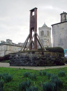 A replica of the Halifax Gibbet on its original site, 2008, with St Mary's Catholic church, Gibbet Street, in the background.