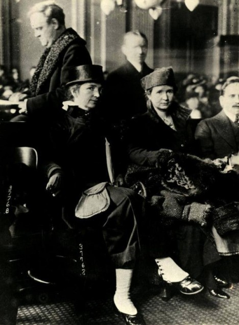 Ethel Byrne, just to the right of center, and her sister, Margaret Sanger, on the left, in court being tried on the charge of disseminating birth control information.