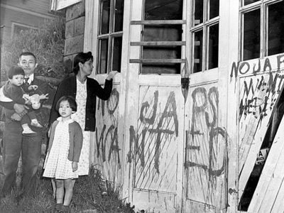 A Japanese family returns home to find their garage vandalized with graffiti and broken windows in Seattle, May, 1945. AP Photo