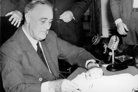 President Franklin D. Roosevelt signs the Selective Service Training Act