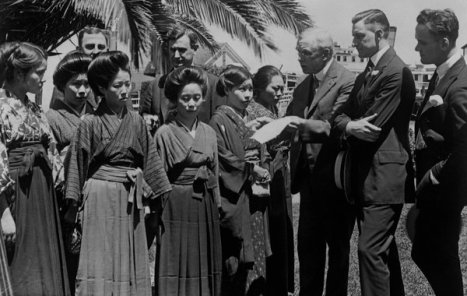 Congressional committee members examine passports of Japanese picture brides at the immigration station of Angel Island, Calif., July 25, 1920