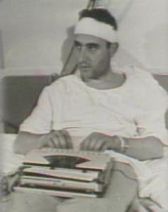 Richard Valeriani filing from his Selma hospital bed on Feb. 19, 1965 (photo courtesy NBC News)