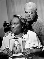 Vernon Darmer's widow, Ellie, holds his photograph, next to her son, Vernon Dahmer, Jr.