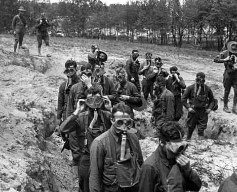 U.S. Soldiers in training, about to enter a tear gas trench at Camp Dix, New Jersey, ca. 1918. (Keystone View Company)