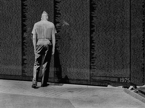 A Marine at Vietnam Memorial on July 4, 2002