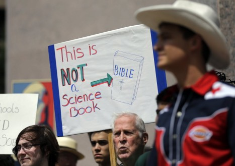 Pro-science supporters rally prior to a State Board of Education public hearing on proposed new science textbooks., Tuesday, Sept. 17, 2013, in Austin, Texas. (Eric Gay, AP photo)