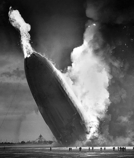 The fire bursts out of the nose of the Hindenburg.