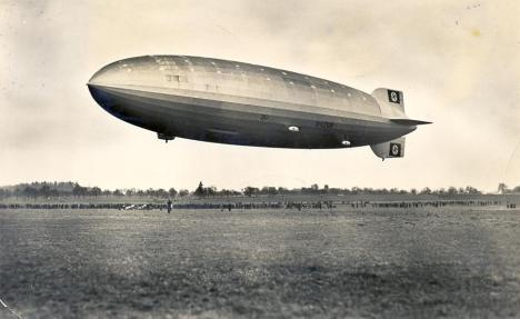 The Hindenburg on its first flight on March 4, 1936. The name of the airship was not yet painted on the hull, but Nazi swastikas can be seen on the fins.