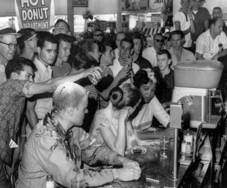 A May 28, 1963, sit-in at a Woolworth's lunch counter in Jackson, Miss., where whites poured sugar, ketchup and mustard over the heads of the demonstrators. (Fred Blackwell/Jackson Daily News via AP file)