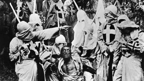 Actors costumed in the full regalia of the Ku Klux Klan in a still from 'The Birth of a Nation.' (Hulton Archive / Getty Images)