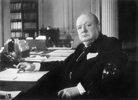 Winston Churchill at his seat in the Cabinet Room at No 10 Downing Street, London