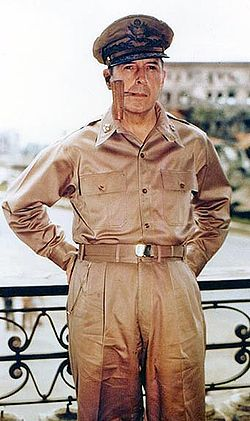 MacArthur in Manila, Philippines c. 1945, smoking his signature corncob pipe