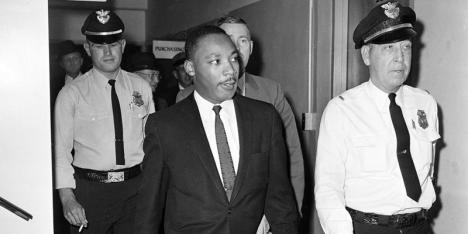Dr. Martin Luther King Jr. leaves court after a four-month sentence in Atlanta, Ga., Oct. 25, 1960, for taking part in a lunch counter sit-in at Rich's department store. (AP Photo)