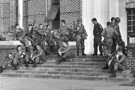 Members of the Alabama National Guard mark time outside an armory in Birmingham, Ala. as they prepare to go on duty at three schools which have been ordered integrated, Sept. 10, 1963. Gov. George Wallace, who barred black students from the schools, called the guard to duty. (AP Photo)