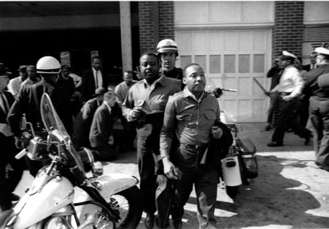 Rev. Ralph Abernathy, left, and Rev. Martin Luther King Jr., right are taken by a policeman as they led a line of demonstrators into the business section of Birmingham, Ala., on April 12, 1963.  (AP Photo)