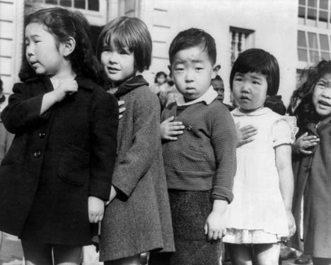 Children at the Weill public school in San Francisco pledge allegiance to the American flag in April 1942, prior to the internment of Japanese Americans.